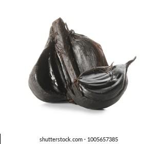 Black garlic (Allium sativum) on white background
