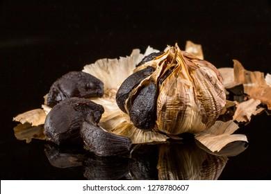 black garlic in black bakground