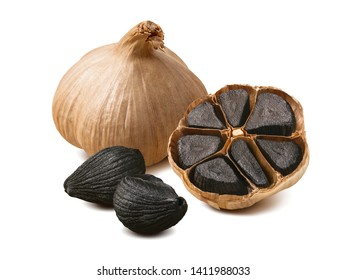 Black garlic bulbs and cloves isolated on white background. Package design composition with clipping path