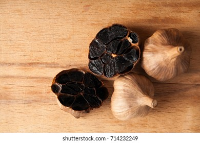 Black garlic close up on wood desk. Food ingredients