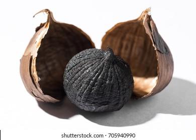 Black Garlic with gloves