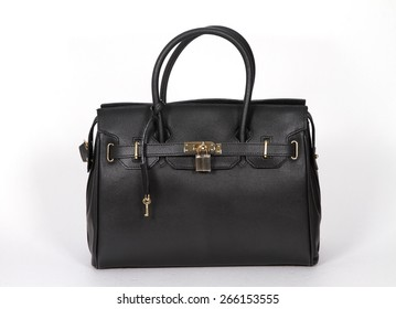 Black genuine leather bag isolated on white background