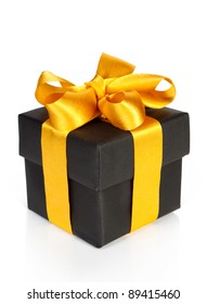 black gift box with golden ribbon isolated on white