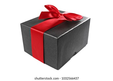 Black gift box with red ribbon isolated on white, shallow focus