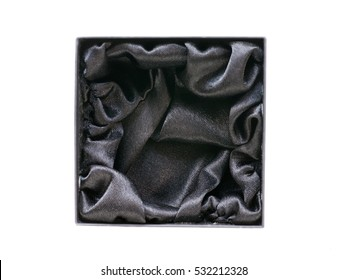 Black gift jewel box with black silk inside. Top view isolated on white