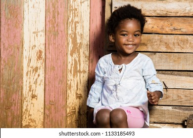 Black girl with a cute smile on her face while looking straight into the camera