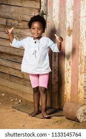 Black girl with a double thumbs up and a very happy expression