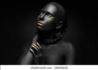 black girl with golden lips and the gold on the tips of the fingers ..