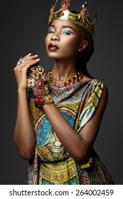 Black girl with jewels on a gray background
