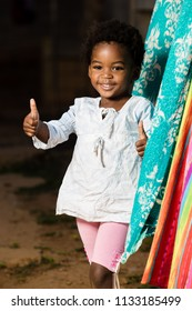 Black girl showing thumbs up with a huge smile on her face
