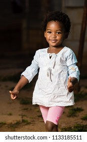 Black girl showing thumbs up with  smile on her face