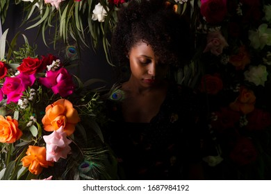 black girl surrounded by flowers