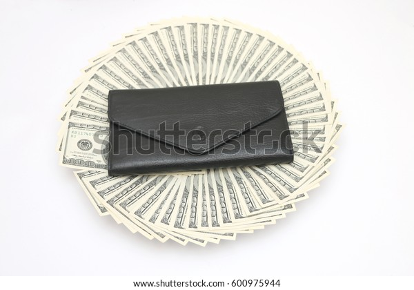 black girl's shirt is a villa with dollar bills.