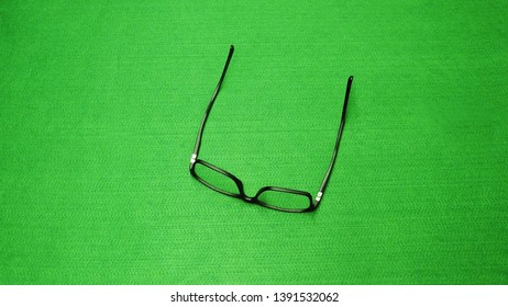 Black glasses with green background