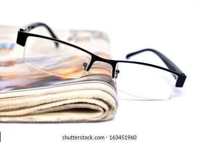 Black glasses on a newspaper