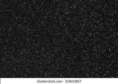 black glitter texture dark background
