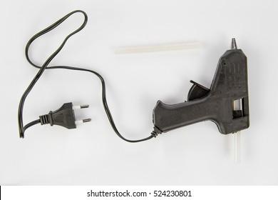 Black glue stick pislol on a white background