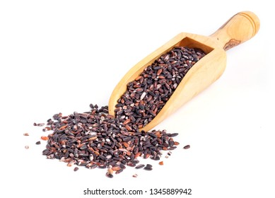 Black glutinous rice on wooden scoop and white background