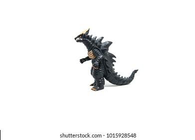 Black godzilla rubber toy with white background