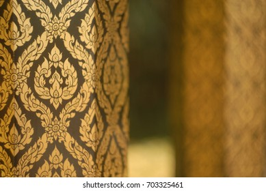 black and gold art on wooden column. asian style. japan