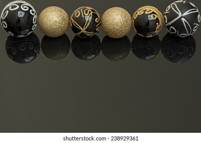 black and gold christmas balls on black background