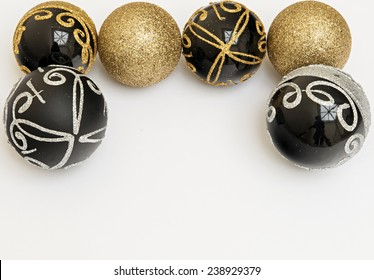 black and gold christmas balls on white background