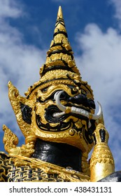 Black and Gold Giant standing in front of the Prachumrat temple ( Thailand called Wat Prachumrat ) gate at Bueng Kham Phroi, Lam Luk Ka, Pathum Thani in Thailand