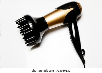 Black and gold hair dryer isolated white background.