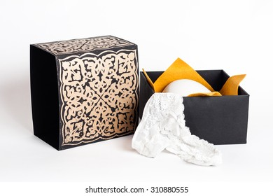 Black and gold and purple underwear box with decorations and artistic signs