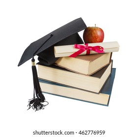 Black graduate hat, stack of big books, red apple and paper scroll tied with red ribbon with a bow, isolated on white background