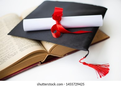 Black graduation cap and degree