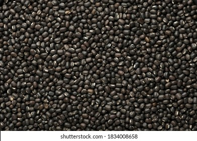Black Gram or Urad Beans or Mung Beans texture. Vigna Mungo is popular indian cuisine food ingredient.