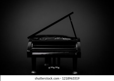 black grand piano at in dark room background.The silhouette of grand piano in a main hall concert.