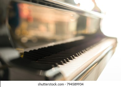 Black grand piano has piano key placed in hallroom. this image for music artist art instrument entertainment concept.
