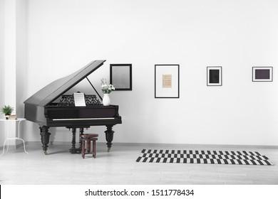 Black grand piano in interior of room