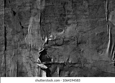Black graphite grey paper background creased crumpled surface old torn ripped posters scary grunge textures