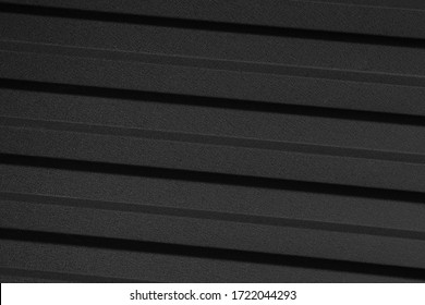 Black and gray lines on a black background. Black background with geometric patterns.