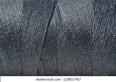 Black gray thread macro background clothing sewing material