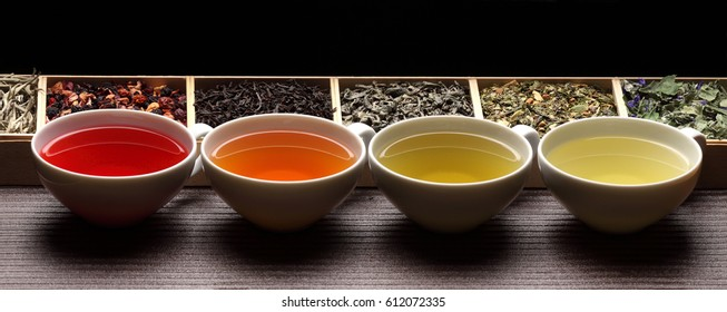 Black, green, herbal tea  cups / tea assortment in boxes