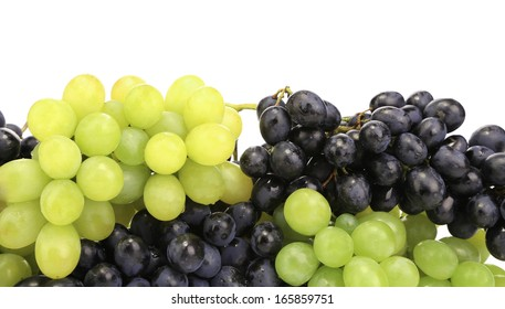 Black and green ripe grapes. There is white space for text