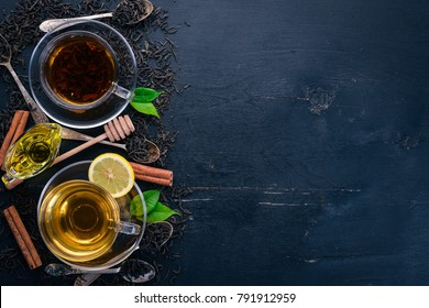 Black and green tea with lemon, honey, cinnamon and ginger. Hot drink Top view. Copy space.