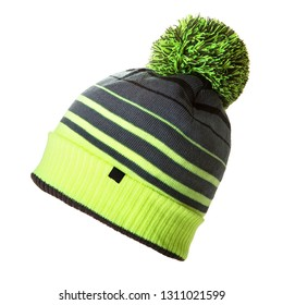 Black and Green Wool Knit Ski Hat with Faux Fur Pompom Isolated on White. Bobble Hat Topped with Pom Pom or Loose Tassels. Knit Cap Folded Brim. Knitted Warm Hat. Tuque or Toque Outdoors Headgear