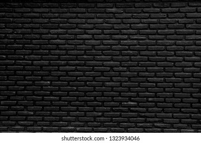 Black  and grey  brick wall cement  clean  horizontal Masonry surface  for wallpaper    background  Textures close up