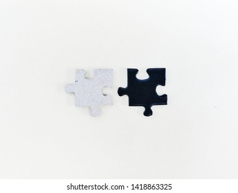 Black and grey puzzle pieces on white background. Complexity concept image.
