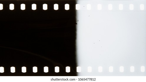 Black grunge dusty scratched filmstrip may be used as background