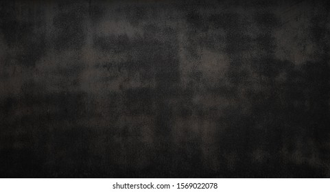 Black grunge metal background or texture with scratches , cracks and rust Is a construction concept