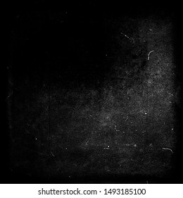 Black grunge scratched background, old film effect, distressed scary halloween texture