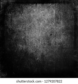 Black grunge scratched scary horror background, distressed texture with frame and space for your text or picture