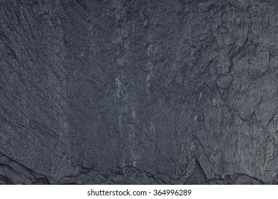 Black grungy stone surface