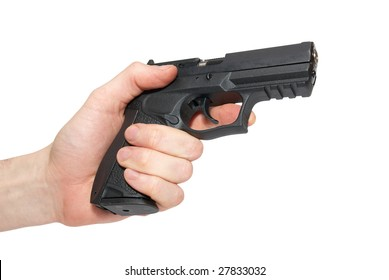 Black gun in a hand isolated on white